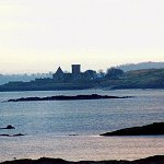 Inchcolm Abbey in the Firth of Forth as seen from Aberdour Castle.