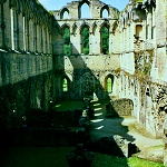 Rievaulx Abbey: The Refectory and its undercroft from the Cloisters of Rievaulx Abbey.
