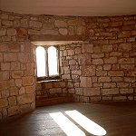 Skipton Castle: Interior view of sunlight streaming through the window in one of the Castle Watch Towers.