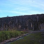 The cloisters of Whalley Abbey.  A cloister consists usually of four corridors, with a courtyard or garth in the middle.