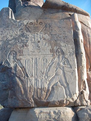 Depecition of the Twin Gods Hapi on the reverse of the Colosus Of Memnon.